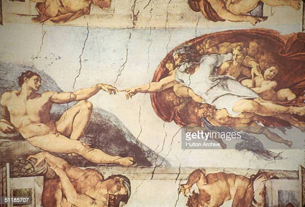 Detail of the ceiling of the Sistine Chapel shows the 'Creation of Adam' a panel in the massive narrative work by Italian artist Michelangelo...
