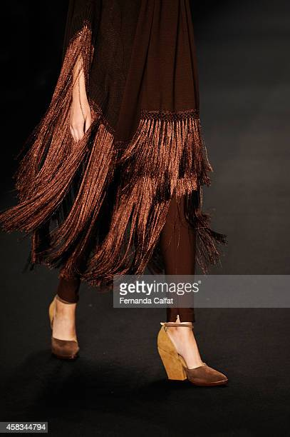 A detail of the clothing on the runway at the Victor Dzenk fashion show during Sao Paulo Fashion Week Winter 2015 at Parque Candido Portinari on...