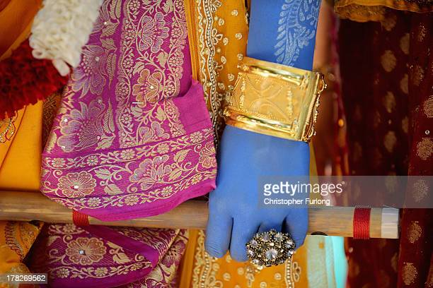 A detail of the colourful costume of Lord Krishna worn by a devotee during the Janmashtami Hindu Festival at Bhaktivedanta Manor on August 28 2013 in...