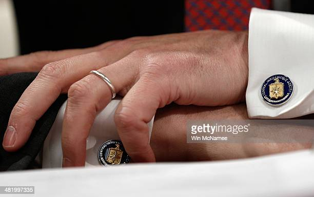 Detail of the cufflinks of former Deputy CIA Director Michael Morell as he testifies before the House Select Intelligence Committee April 2 2014 in...