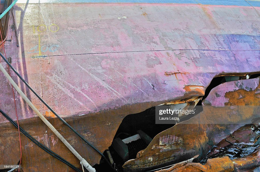 A detail of the damage that the Costa Concordia suffered during a collision which has become the subject of the investigations of the Codacons experts is seen on July 25, 2012 in Giglio Porto, Italy. The Codacons is a group of university professors and experts engaged in the work of data analysis of the black box and procedural documents relating to the investigation of the sinking of the Costa Concordia cruise liner. A preliminary court hearing into the incident starts on October 15, 2012 in Grosseto, Italy, during which experts will present their findings.