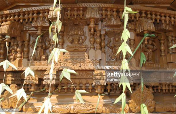 Detail of the elaborate carvings adorning one of the wooden chariots during the Mahotsava Festival at a Tamil Hindu temple in Ontario Canada