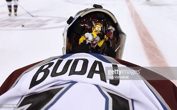 Detail of the facemask worn by goaltender Peter Budaj of the Colorado Avalanche as he warms up prior to the NHL game against the St Louis Blues on...