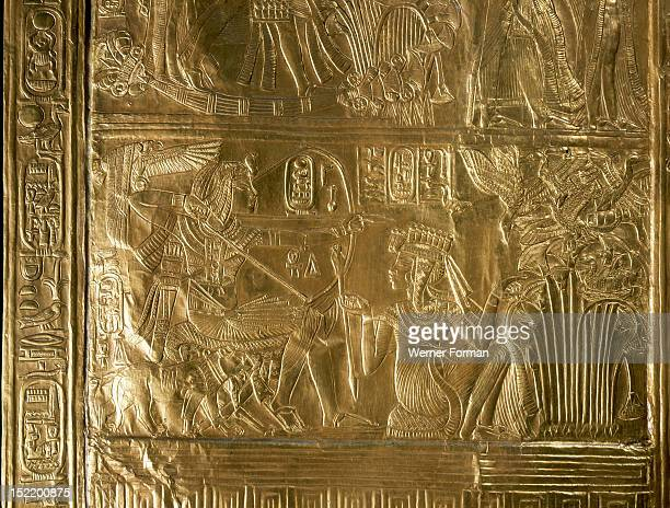 A detail of the gilt shrine of Tutankhamun which originally contained statuettes of the royal couple The scene depicts a ritual hunting scene in...