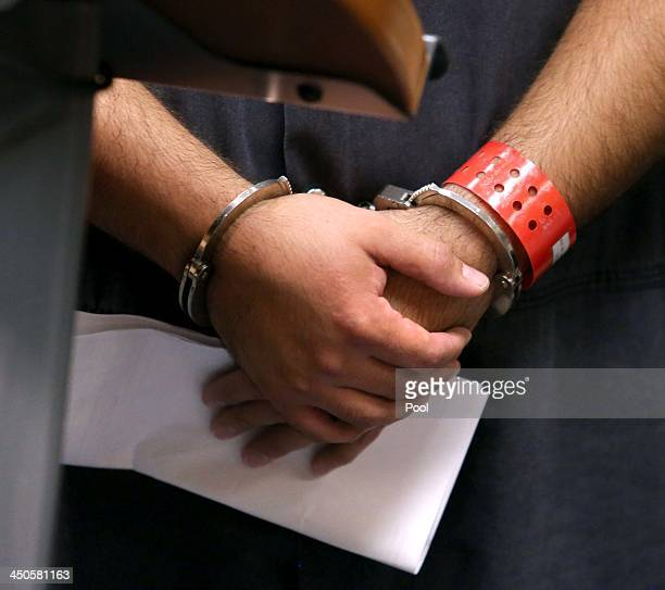 Detail of the handcuffed hands of George Zimmerman the acquitted shooter in the death of Trayvon Martin faces a Seminole circuit judge during a...