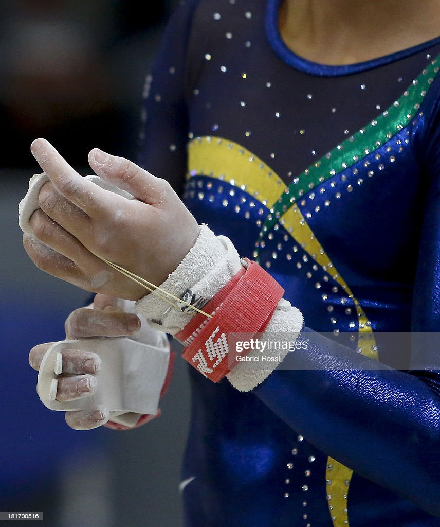 Detail of the hands of Flavia Lopes Saraiva of Brazil during the Women's Team all-around as part of the I ODESUR South American Youth Games at Coliseo Miguel Grau on September 23, 2013 in Lima, Peru.