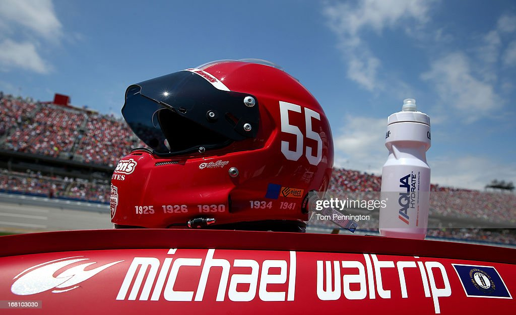 A detail of the helmet worn by Michael Waltrip, driver of the #55 Aaron's Dream Machine / Alabama National Championship Toyota, is seen on top of Waltrip's car on the grid during the NASCAR Sprint Cup Series Aaron's 499 at Talladega Superspeedway on May 5, 2013 in Talladega, Alabama.