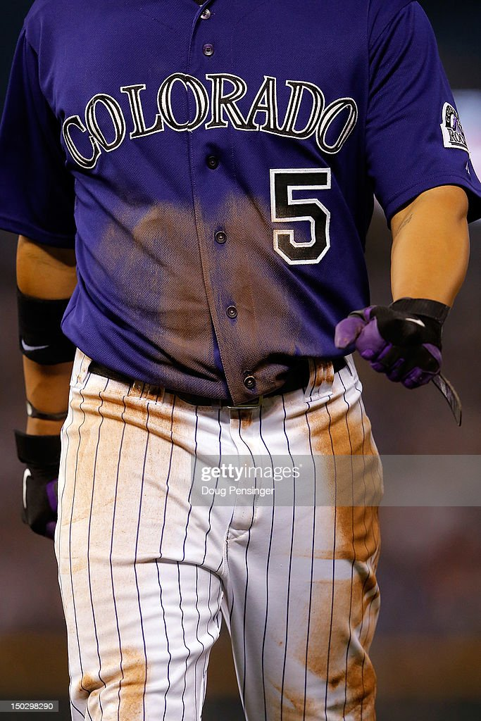 A detail of the jersey of Carlos Gonzalez #5 of the Colorado Rockies as he returns to the dugout after being caught stealing against the Milwaukee Brewers at Coors Field on August 14, 2012 in Denver, Colorado. The Rockies defeated the Brewers 8-6.