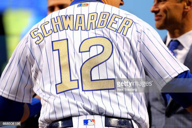 Detail of the jersey of Kyle Schwarber of the Chicago Cubs as he takes the field during the World Series ring ceremony ahead of the game between the...
