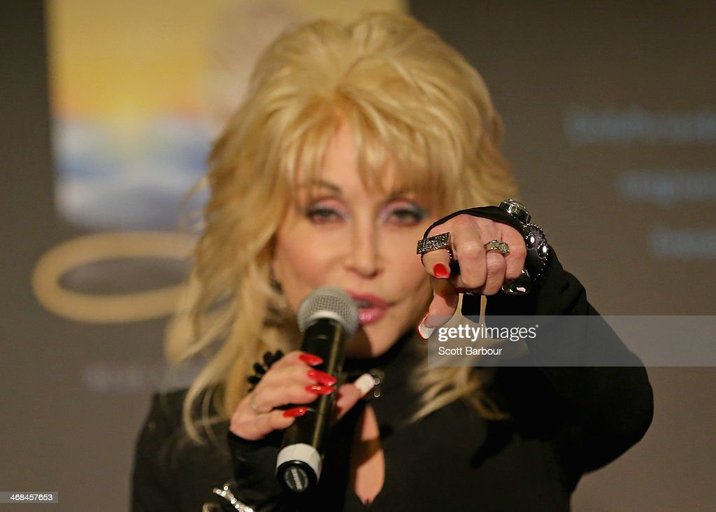 A detail of the jewellery worn by <a gi-track='captionPersonalityLinkClicked' href=/galleries/search?phrase=Dolly+Parton&family=editorial&specificpeople=220238 ng-click='$event.stopPropagation()'>Dolly Parton</a> as she speaks to the media during a press conference at Rod Laver Arena on February 11, 2014 in Melbourne, Australia.