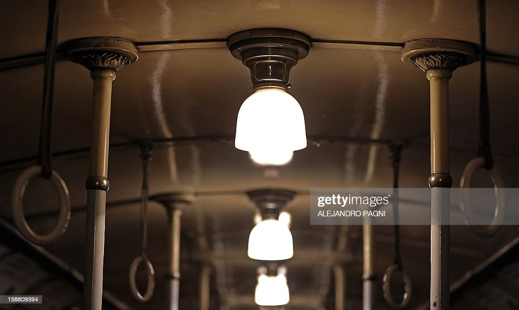 Detail of the lamps of one of the historic wagons La Brugeoise of subway Line A, which is expected to be close soon following a decision by city mayor Mauricio Macri to replace the fleet with Chinese-made wagons, in Buenos Aires, on December 29, 2012. Line A was the first subway line to work in the southern hemisphere and its trains are among the ten oldest still working daily. The La Brugeoise wagons were constructed between 1912 and 1919 by La Brugeoise et Nicaise et Delcuve in Belgium. AFP PHOTO / ALEJANDRO PAGNI --- MORE PICTURES IN IMAGE FORUM