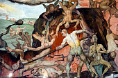 A detail of The Last Judgement part of Vasari's frescoes adorning the Brunelleschi's dome of Florence Cathedral or Basilica of Saint Mary of the...