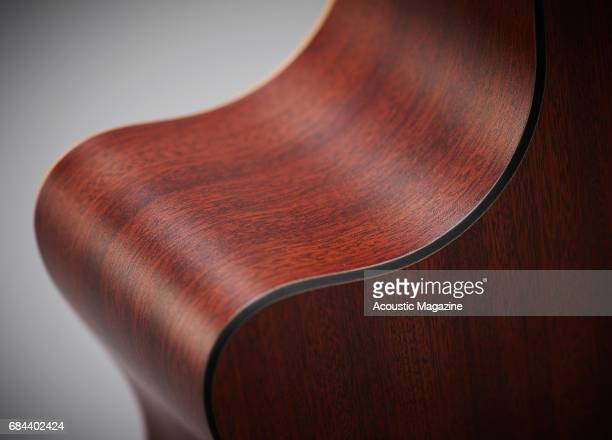 Detail of the mahogany back and sides on a CF Martin and Co GPCX1AE electroacoustic guitar taken on September 23 2016