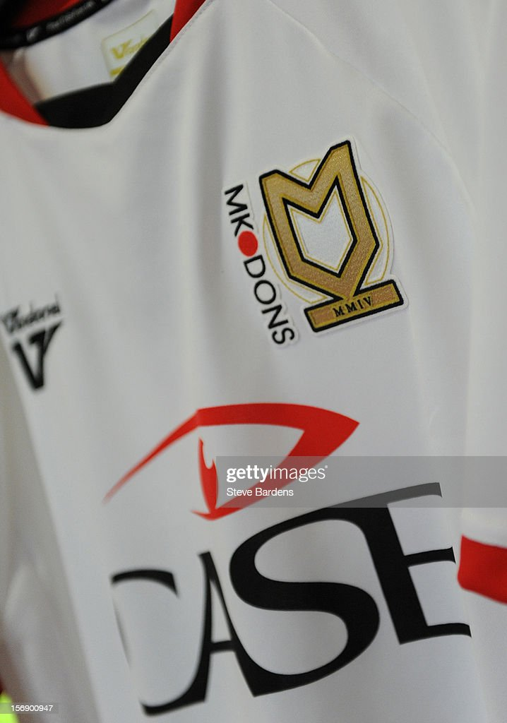 Detail of the MK Dons club crest on a football shirt on sale in the club superstore at the Stadium MK before the npower League One match between MK Dons and Colchester United at Stadium MK on November 24, 2012 in Milton Keynes, England.
