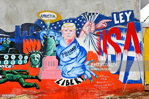 Detail of the mural paint made by Mexican artist Luis Sotelo called 'We are migrants not criminals' in Tonatico Mexico on 25 June 2016 The mural is...