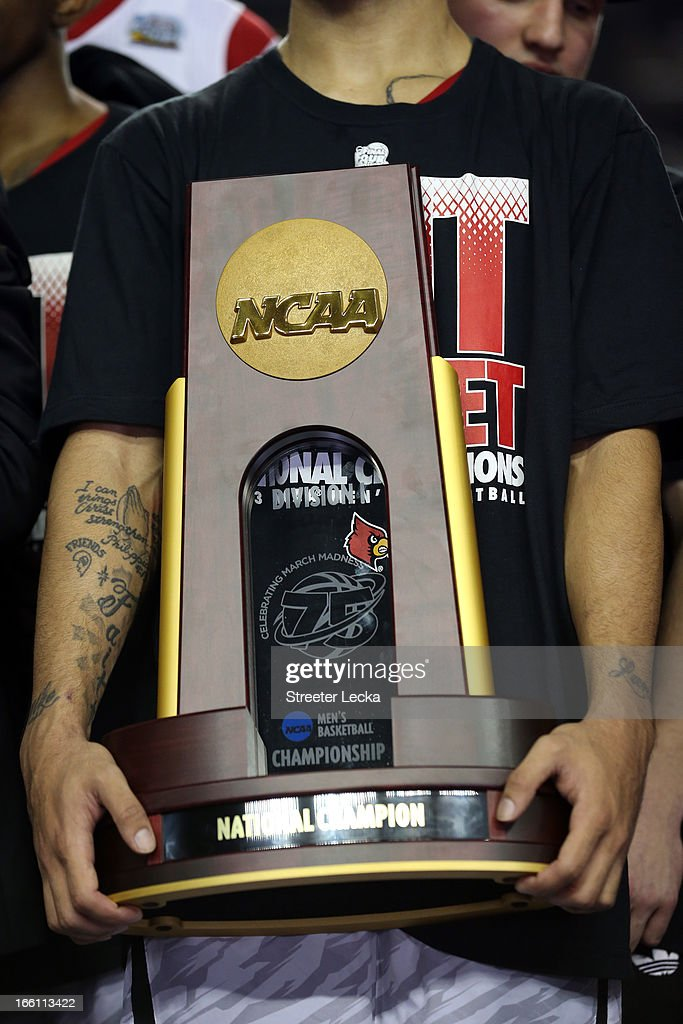 A detail of the National Championship trophy held by Peyton Siva #3 of the Louisville Cardinals after they won 82-76 against the Michigan Wolverines during the 2013 NCAA Men's Final Four Championship at the Georgia Dome on April 8, 2013 in Atlanta, Georgia.