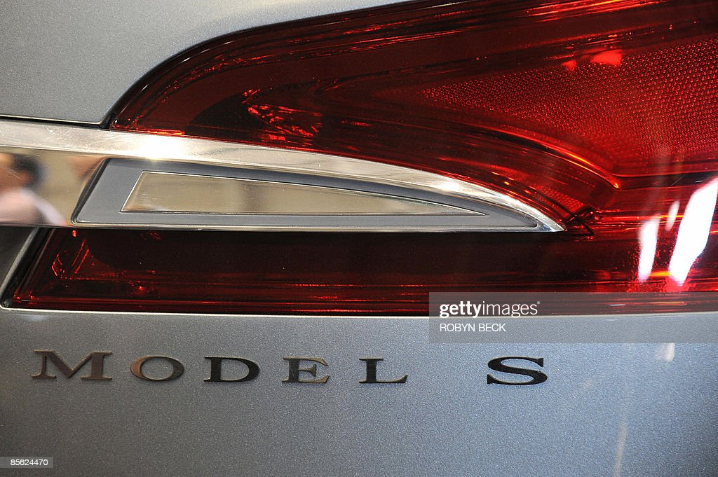 A detail of the new Tesla Model S all-electric sedan (L), at the car's unveiling in Hawthorne, California on March 26, 2009. Musk said the state-of-the-art, five-seat sedan will be the world's first mass-produced, highway-capable electric car. The car has an anticipated base price of 57,400 US dollars but will cost less than 50,000 after a federal tax credit of 7,500 dollars. AFP PHOTO / Robyn BECK