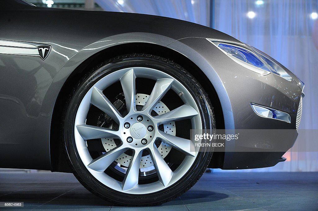 A detail of the new Tesla Model S all-electric sedan is pictured at the car's unveiling in Hawthorne, California on March 26, 2009. Tesla motors says the state-of-the-art, five-seat sedan will be the world's first mass-produced, highway-capable electric car. The car has an anticipated base price of 57,400 US dollars but will cost less than 50,000 after a federal tax credit of 7,500 dollars. AFP PHOTO / Robyn BECK