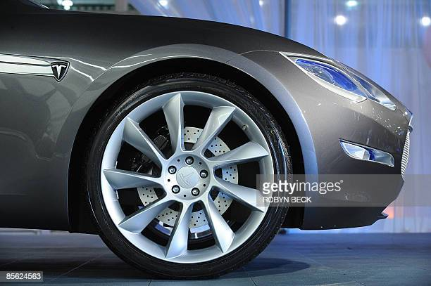 A detail of the new Tesla Model S allelectric sedan is pictured at the car's unveiling in Hawthorne California on March 26 2009 Tesla motors says the...