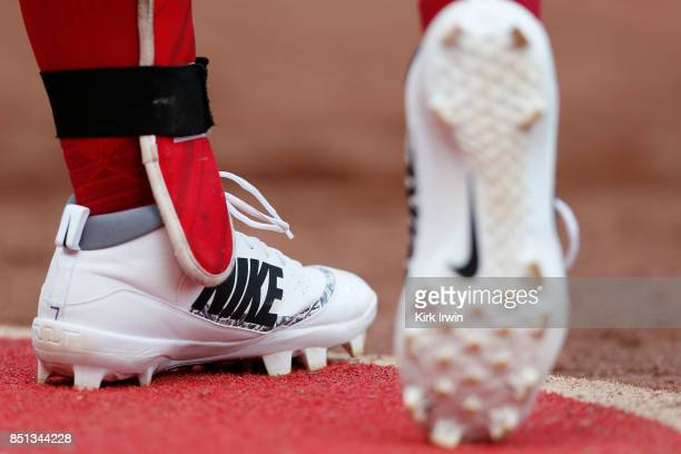 A detail of the Nike baseball cleats worn by Eugenio Suarez of the Cincinnati Reds during the game against the Pittsburgh Pirates at Great American...