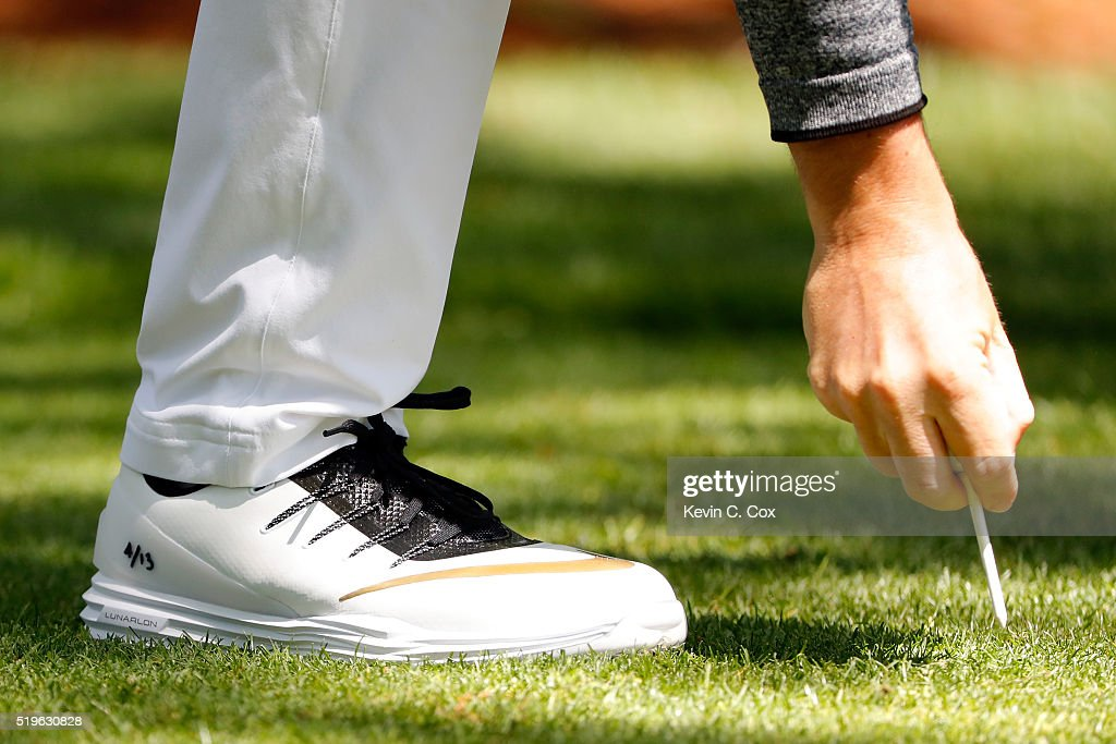 A detail of the Nike shoes Rory McIlroy of Northern Ireland on the first hole during the first round of the 2016 Masters Tournament at Augusta...