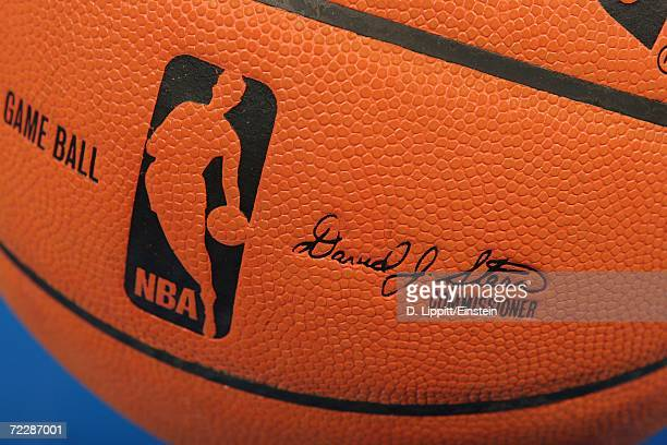 A detail of the official NBA logo and commissioner's signature on the new microfiber composite basketball used during the preseason game between of...