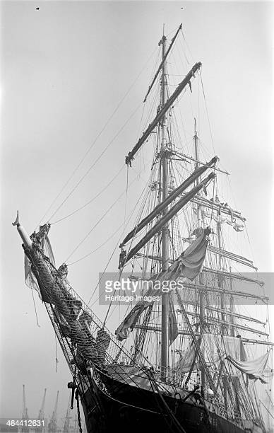 Detail of the prow and rigging of a large sailing ship the 'Pamir c1945c1965 Four cranes for loading and unloading cargo can be seen in the distance
