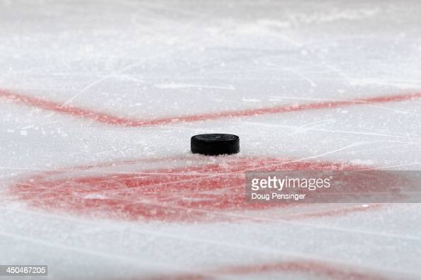 A detail of the puck as it rests on the face off circle during a break in the action between the Florida Panthers and the Colorado Avalanche at Pepsi...