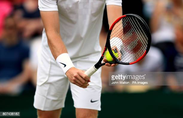 Detail of the racquet and Nike wristbands of Kyle Edmund during his match against Alexander Ward on day two of the Wimbledon Championships at The All...