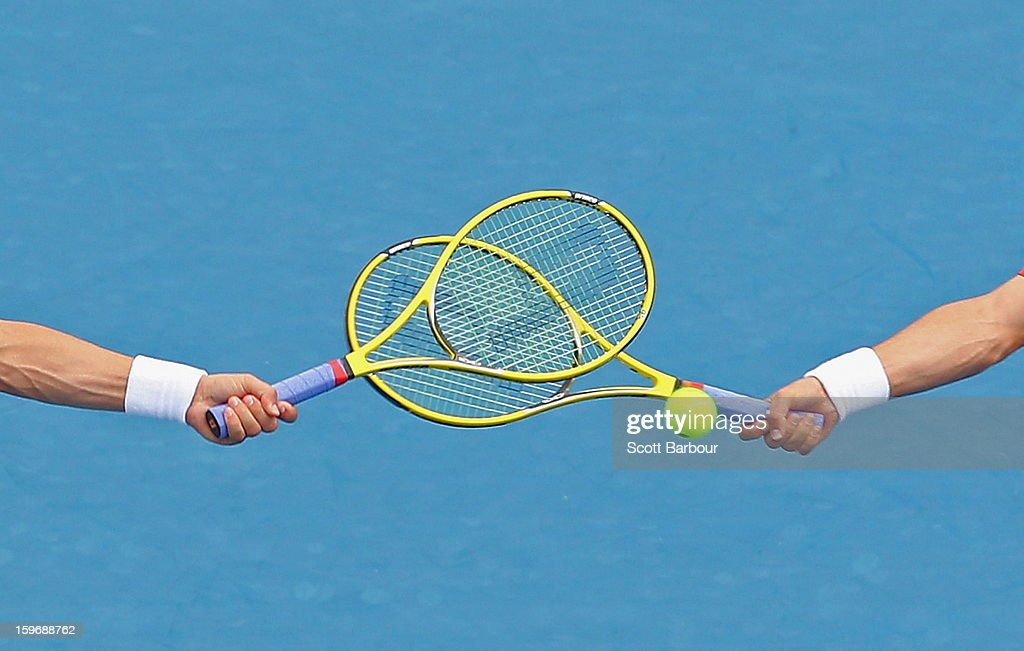 A detail of the racquets of <a gi-track='captionPersonalityLinkClicked' href=/galleries/search?phrase=Bob+Bryan&family=editorial&specificpeople=203335 ng-click='$event.stopPropagation()'>Bob Bryan</a> of the United States and <a gi-track='captionPersonalityLinkClicked' href=/galleries/search?phrase=Mike+Bryan&family=editorial&specificpeople=204456 ng-click='$event.stopPropagation()'>Mike Bryan</a> of the United States as they compete in their men's second round doubles match against Flavio Cipolla of Italy and Andreas Seppi of Italy during day five of the 2013 Australian Open at Melbourne Park on January 18, 2013 in Melbourne, Australia.