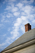 Detail of the roof and chimney of a house