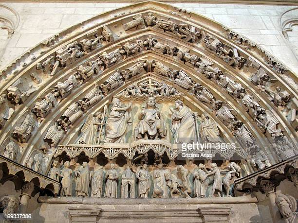 Detail of the sculptures in the tympanum and jambs of the door of Coroneria depicting the Last Judgment and God enthroned executed in classic Gothic...