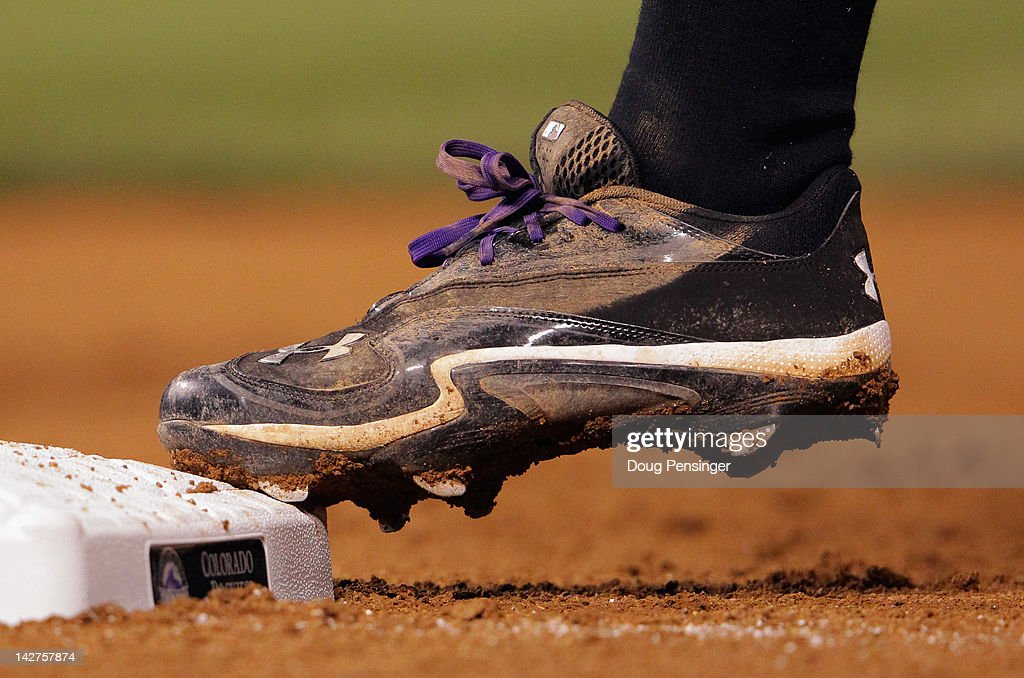 A detail of the shoe of Chris Nelson of the Colorado Rockies as he reaches first base against the San Francisco Giants at Coors Field on April 11...