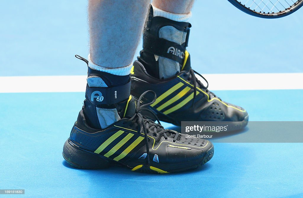 A detail of the shoes and ankle supports worn by Andy Murray of Great Britain during a practice session ahead of the 2013 Australian Open at Melbourne Park on January 9, 2013 in Melbourne, Australia.