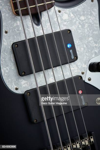 Detail of the Sims Super Quad pickups on an Enfield Avenger II 5 bass guitar taken on October 14 2016