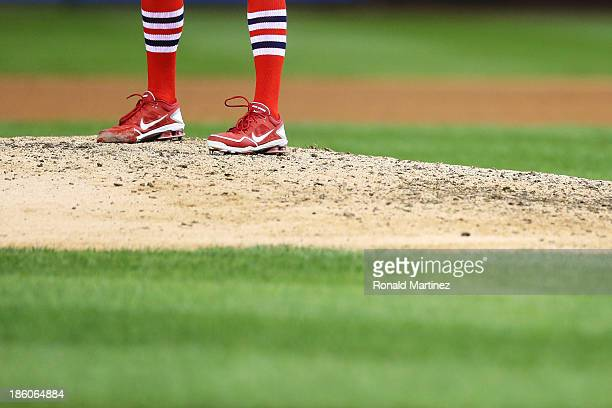 A detail of the socks of John Axford of the St Louis Cardinals during Game Four of the 2013 World Series against the Boston Red Sox at Busch Stadium...