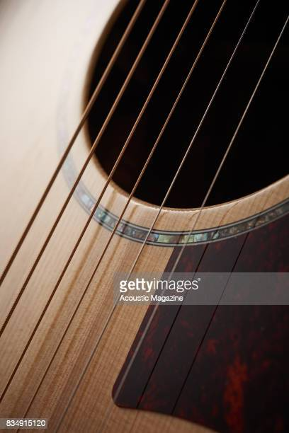Detail of the sound hole and abalone rosette on a Cort Grand Regal GA5FMD NAT electroacoustic guitar taken on November 16 2016