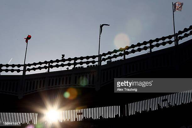A detail of the sun shinning through the facade atop the stadium as the New York Yankees host the Detroit Tigers during Game Two of the American...