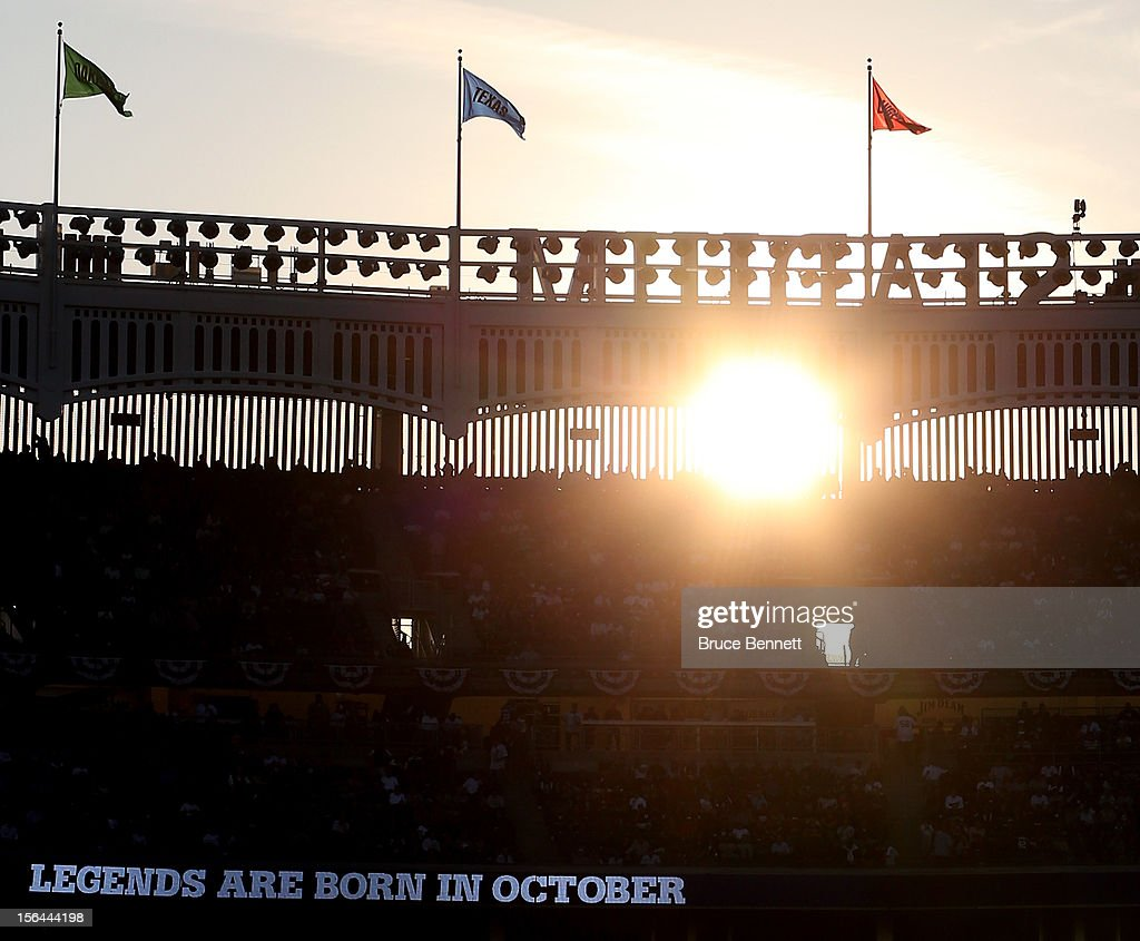 A detail of the sun shinning through the facade atop the stadium as the led board reads 'Legends are born in October' while the New York Yankees host the Detroit Tigers during Game Two of the American League Championship Series at Yankee Stadium on October 14, 2012 in the Bronx borough of New York City.