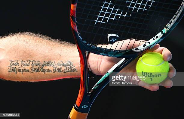 A detail of the tattoo on the arm of Stan Wawrinka of Switzerland as he prepares to serve in his third round match against Lukas Rosol of the Czech...