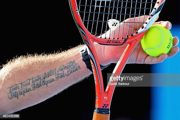 A detail of the tattoo on the arm of Stanislas Wawrinka of Switzerland as he prepares to serve in his quarterfinal match against Kei Nishikori of...