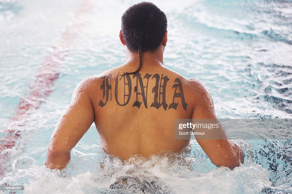 A detail of the tattoo on the back of Mahe Fonua of the Storm as he walks in the water during a Melbourne Storm NRL recovery session at AAMI Park on March 11, 2013 in Melbourne, Australia.