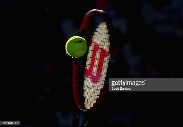 A detail of the tennis racquet hitting the ball as Roger Federer of Switzerland serves in his third round match against Andreas Seppi of Italy during...