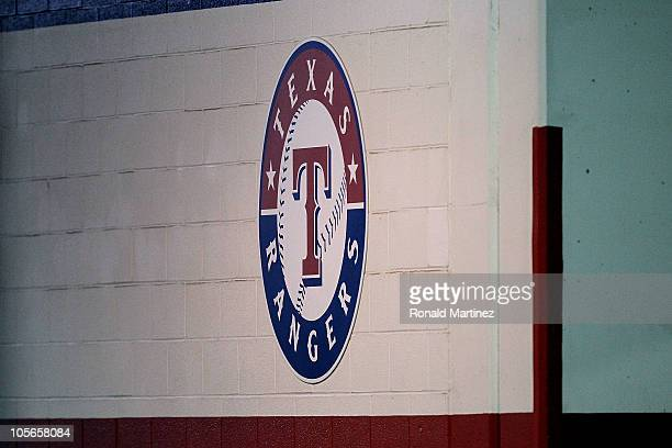 A detail of the Texas Rangers logo painted on the wall outside the locker room is seen against the New York Yankees in Game One of the ALCS during...