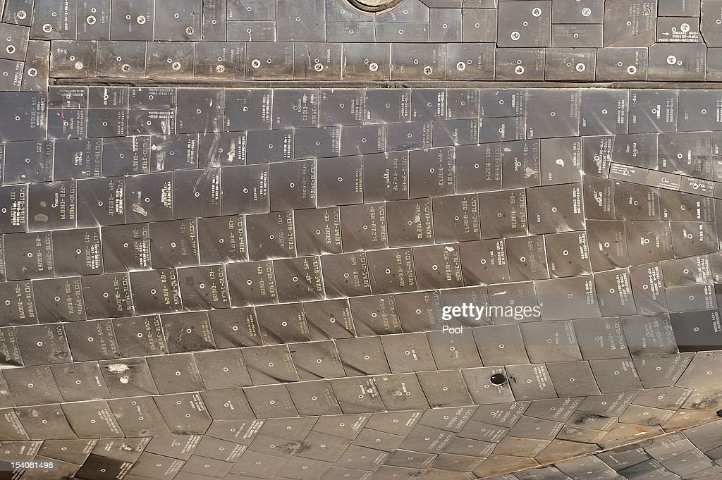 A detail of the tiles on the underside of Space Shuttle Endeavour as it arrives at the Forum enroute to the California Science Center on October 13, 2012 in Inglewood, California. Endeavour is on its last mission - a 12-mile creep through city streets, past an eclectic mix of strip malls, mom-and-pop shops, tidy lawns and faded apartment buildings. Its final destination is the California Science Center in South Los Angeles where it will be put on display. NASA's Space Shuttle Program ended in 2011 after 30 years and 135 missions.