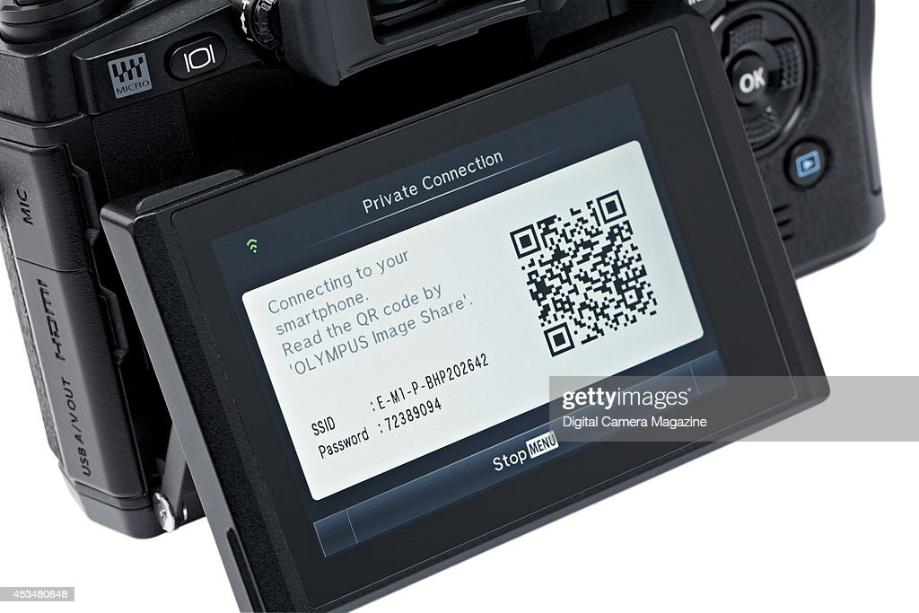 Detail of the tilting LCD screen and wireless connection options on an Olympus OM-D E-M1 compact system camera, on November 4, 2013.