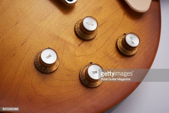 Detail of the tone and volume knobs on a Gibson Les Paul electric guitar taken on March 4 2016