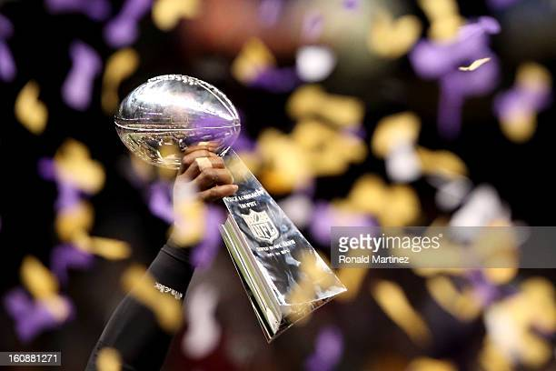 A detail of the Vince Lombardi Championship trophy held up by a player from the Baltimore Ravens as confetti falls after the Ravens won 3431 against...