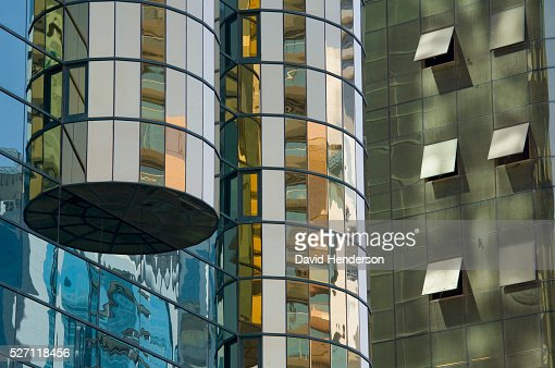 Detail of two adjacent mirrored skyscrapers : Stock Photo
