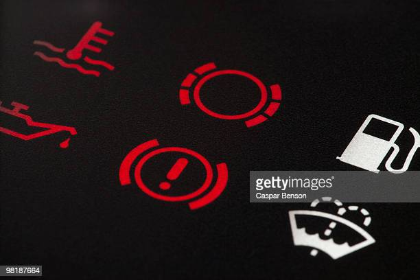 Detail of warning lights on a car dashboard